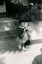 Circa 1953 - kathie with broom