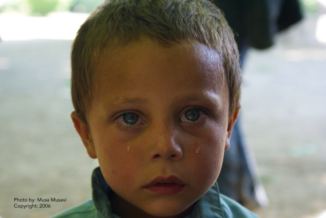 Crying Afghan kid by Musa Musavi